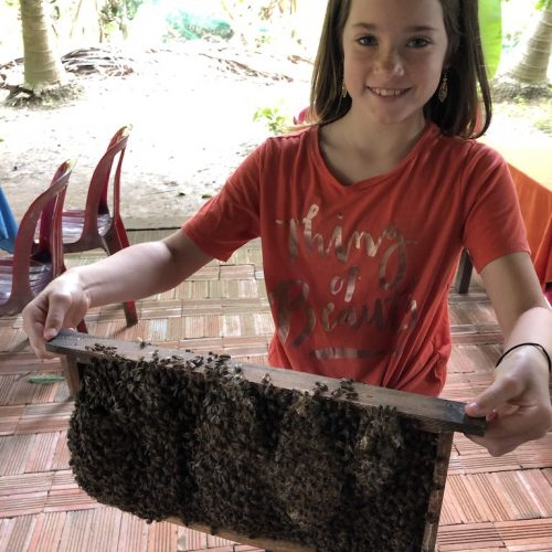 Grace was the first to volunteer to hold the bee hive